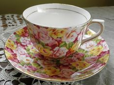 This is a beautiful rose flora chintz cup and saucer manufactured by Colclough China Ltd. in Longton, England c.1939-48.  They are decorated with an all over floral chintz of pink and yellow roses and green leaves, with light gilding.
