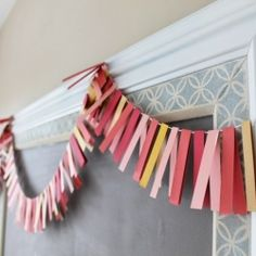 Make this whimsical banner for your next party with strips of paper and twine!