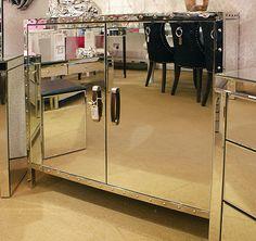 Chrome edged mirrored glass sideboard cupboard