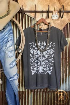 The Southwesterner - Southwest pattern graphic tee. Otomi southwest original design. White distressed graphics on a charcoal tee. Soft quality fabric. Rocker tee fit - loose oversized fit. Runs a size big, Small fits size 4-6.