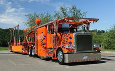 Orange car hauler Peterbilt w/ purple flames