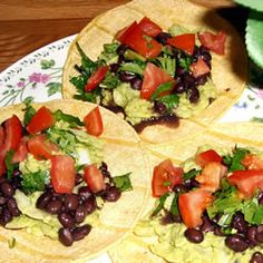 Avocado Tacos  3 avocados - peeled, pitted, and mashed  1/4 cup onions, diced  1/4 teaspoon garlic salt  12 (6 inch) corn tortillas  1 bunch fresh cilantro leaves, finely chopped  jalapeno pepper sauce, to taste