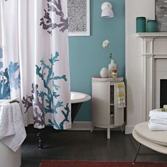 West Elm Bathroom ~ click to find out more about the items listed in this photo.  I ♥ the Turquoise Sea Glass Containers on the fireplace mantel.  Made from recycled glass in Mexico, they are roomy enough to work as bathroom accessory holders, kitchen catchalls, etc.  They're really  beautiful!
