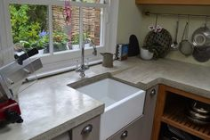 Polished bespoke concrete worktop with sloped drainer