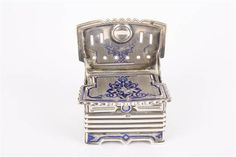 An unusual 19th century Russian silver and enamel novelty vesta in the form of a settle with scro
