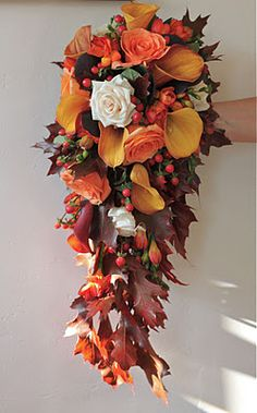 Oak leaves, berries, roses & freesias in gorgeous autumnal colours.