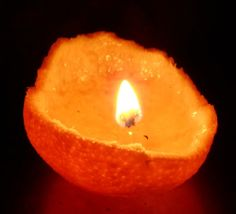 """This is the neatest thing. Clean out an orange, and make a wick from part of the stringy white stuff. Fill the orange peel with olive oil, light the """"wick"""" and that's it. And it smells like oranges! I really like this site a lot.   Plain and Joyful Living: An Orange Olive Oil Candle."""
