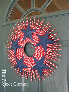 Easy and inexpensive ...patriotic wreath   As a Canadian I would use the Maple Leaf