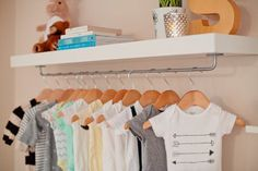 Perfect for a nursery or older kids room. Take ikea lack shelf and add bygel rail at bottom. Perfect for hanging bins from Ikea.