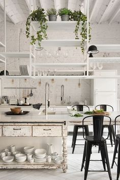 Located in central Barcelona, this apartment was completely renovated by architects Serrat-Torn & interior designer Marta Castellant. The two-floor apartment has an industrial style, with bohemian inf