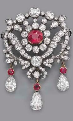 AN ANTIQUE RUBY AND DIAMOND BROOCH The central cushion-shaped ruby and old-cut diamond cluster to the openwork diamond floral surround, suspending three detachable pear-shaped diamond and ruby drops, mounted in silver and gold, circa 1880, 6.2 cm. high