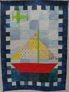 Wavy lines soften the patchwork background and introduce the illusion of a light breeze or gentle clouds. Quilting Projects, Quilting Designs, Sewing Projects, Cute Quilts, Small Quilts, Baby Boy Quilts, Children's Quilts, Amish Quilts, Christmas Tree Skirts Patterns
