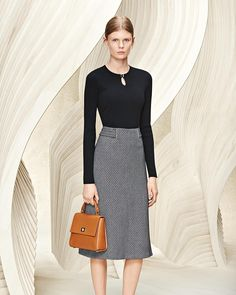 From hugoboss - Effortless elegance in monochrome complemented by #bossbespokebag in tan calf leather #thisisboss