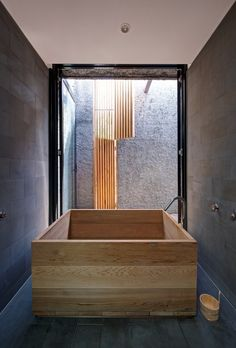 Wood bathtub at house in inner city Melbourne, Australia by Jessica Liew