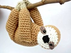 Sloth stuffed animal: - Crocheted using a 100% cotton yarn and filled with fiberfill stuffing. - His eyes are made with plastic safety eyes. - Measurements: 12 cm (4,7 inches) length and 9 cm (3,5 inches) width. - Colors: hazel (body), cream (muzzle), black (nose), beige (paws). This adorable sloth is taking it easy and wants to be carried everywhere with you. His arms are sewn together, in this way he can easily be hung everywhere you want. This cute little sloth makes a wonderful best…