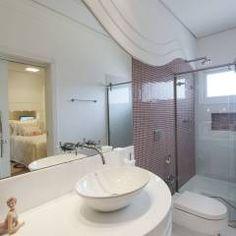 Casa Limeira: Banheiros translation missing: br.style.banheiros.moderno por Arquiteto Aquiles Nícolas Kílaris