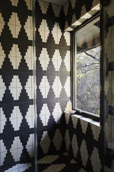 Graphic black and white cement tile was added in the renovation. Tagged: Bath Room, Stone Tile Wall, Open Shower, and Cement Tile Floor.  Photo 13 of 15 in A Hudson Valley Home's Renovation Is Guided by its Best Midcentury Feature