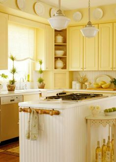 I am lovin' the yellow cabinets.