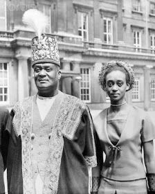 George Rukidi, the Omukama of the Toro Kingdom of Uganda, photographed with his daughter, Princess Elizabeth, after he had been created a Knights Bachelor by H.M. Queen Eliizabeth II at the Investiture.