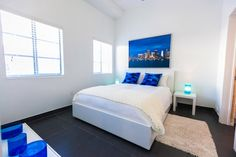 White Bedroom Furniture Sets With Blue Wall Window And Black Ceramic Bde