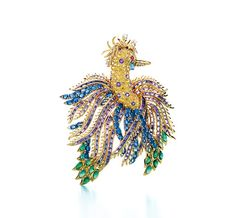 Jean Schlumberger's jeweled 'Phoenix' clip, 1948, a bird from whose yellow diamond and amethyst breast blooms a bounty of billowing plumage in blue and yellow sapphires, cabochon emeralds, and baguette-cut amethysts and whose ruby eye sheds a single aquamarine tear.