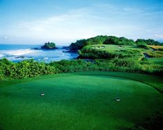 Dramatic view: The signature hole of Par 3, 7th with the iconic Tanah Lot temple as the backdrop. The Nirwana Golf Cours...