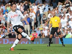 After Alex Kacaniklic is tripped by Billy Jones, Berbatov adds his second from the spot.