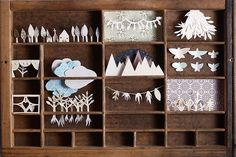 Papercuts in a wood box