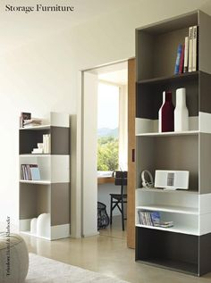 Fancy Ligne Roset Book and Look Rotating Tower Structure resting on a rotating ball bearing mechanism The MDF supportbase is weighted with a steel dis u