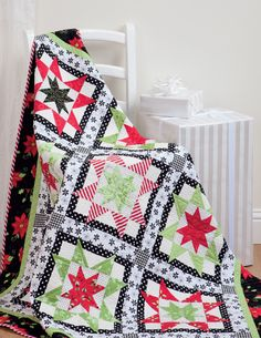 """What happens when a traditional quilter gets bit by the modern quilting bug and heads into the holidays? Simply Modern Christmas—a new book celebrating the most quilt-happy holiday of the year! Click through to see all the quilts, including """"Peppermint Float."""""""