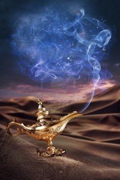 Aladdin magic lamp on a desert with smoke Stock Photo