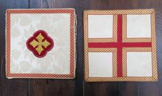Burse Pair Red Cream and Gold  LH: Cream damask with red and gold infinity patterned braid border and velvet quatrefoil appliqué with gold embroidered cross. Some wear to the damask  RH: Gold and red infinity patterned braid with a central red panel on a cream background.