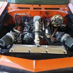 69 chevelle orange. twin turbos 383 stroker. 15 pounds of boost and meth injection with a mega squirt computer system. $5000 for the turbo kit. boosted two turbo