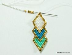 I recently purchased a small package of Miyuki 24 karat gold plated Delicas, and they have raised my bead stitched pendants to a whole new level of glam. I am so glad I made that purchase. Textile Jewelry, Bead Jewellery, Seed Bead Jewelry, Beading Patterns Free, Beaded Bracelet Patterns, Beaded Bracelets, Weaving Patterns, Bead Patterns, Knitting Patterns