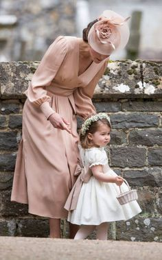 Catherine Duchess of Cambridge and Princess Charlotte of Cambridge attend the wedding of Pippa Middleton and James Matthews at St Mark's Church on...