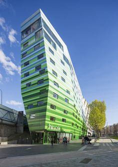 The tapered shape of the Hipark Hotel in Paris is designed to points towards its famous neighbour – the Jean Nouvel-designed Philharmonie de Paris. Gautrand's building, which comprises offices, student accommodation and an apartment hotel, is covered in panels that transition from green to blue and white at the top.