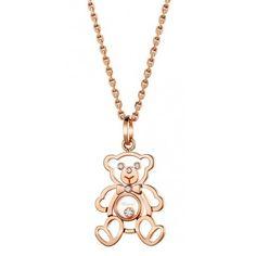 Chopard Pendentif - Happy Diamonds Le pendentif Ours Chopard Happy Diamonds est un très joli modèle en or rouge 18 carats avec quatre diamants fixes et un Happy Diamond fl...