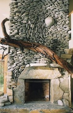 Ancient Art of Stone - river stone and drift wood fireplace