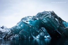 """While on an expedition in Antarctica, photographer Alex Cornell had the rare opportunity to photograph a recently flipped iceberg. Defining the old adage """"just the tip of the iceberg,"""" it turns out the underside can be illuminated with unbelievable bright blues and striation that reveal visually stunning secrets of these sleeping giants."""