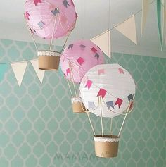 Hot air balloon mobiles to make using paper lantern,   skewers, twine, paper bunting, ice cream style paper cup base.