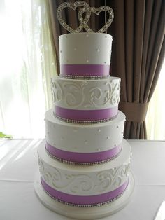White and purple wedding cake (1993) | Flickr - Photo Sharing! - this is the only cake topper I like! maybe even a bit smaller too