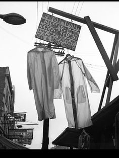Two Shirts Hanging, Maxwell St, Chicago, Vivian Maier Vivian Maier, Black White Photos, Black And White Photography, Street Photography, Art Photography, Fotografia Social, Chicago, New York City, Great Photographers