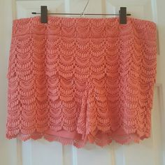 LOFT Scallop Hem Crochet Shorts LOFT Scallop Hem Crochet Coral Shorts. Lined. Approx 4 inch inseam. This shorts do not have pockets. Side Zip. Excellent condition. LOFT Shorts