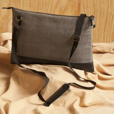 Space Gray Genuine Laptop Bag. https://www.qtrove.com/products/space-gray-laptop-bag Fits up-to 15 inch laptop and has 4 compartments.This slim bag will make you fall in love with it. https://www.qtrove.com/products/space-gray-laptop-bag