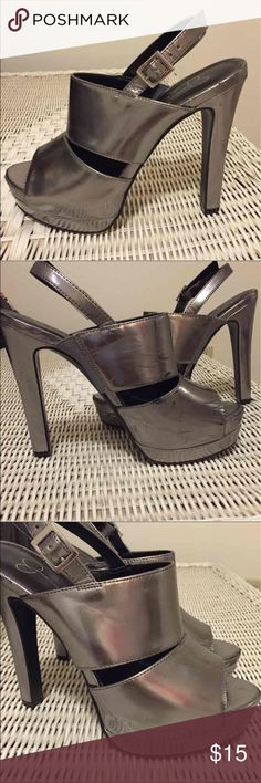 Jessica Simpson heels Grey metallic heels great party shoes my go to, super cute, wear on the heels as you can see on the heel and inside of the shoe outside of heel perfect condition front shoe had some wear as well still plenty of use left just looking for a new home so comfy perfect for dancing Jessica Simpson Shoes Heels