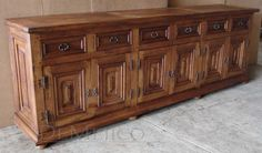 Colonial Buffet 8ft.   This cabin style buffet is inspired by the late 19th century Spanish styling with the use of powerful wrought iron hardware and unique panel design.(10 ft Colonial Buffet REF* BUF-2006).   Model: BUF-2005  96 in X 42 in X 22 in.  http://www.demejico.com/wp-content/uploads/2011/11/custom-spanish-style-cabinets-1024x602.jpg