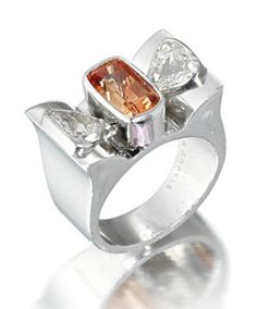 A padparadscha sapphire and diamond ring, by Van Cleef & Arpels The rectangular mixed-cut padparadscha sapphire, weighing 3.00 carats, between shoulders set with triangular-cut diamonds, mounted in platinum, diamonds approximately 1.00 carat total, signed Van Cleef & Arpels