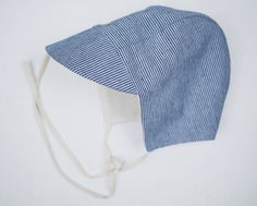 Our classic cap with brim and ties. Made with 100% linen with cotton lining. Breathable and perfect for your wee ones tiny head. This cap looks it's best when it fits snug. * Handmade in Squamish, British Columbia* All garments are made to order, please allow 4 weeks before shipment.