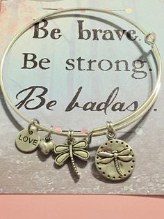 A personal favorite from my Etsy shop https://www.etsy.com/listing/508465003/inspirational-brave-charm-bangle