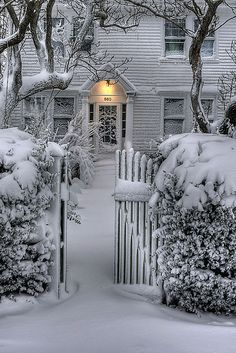 The gate is open - the porch light is on ... this looks so welcoming. Hope there is a steaming mug of hot cocoa waiting to be enjoyed in front of a crackling fire :)